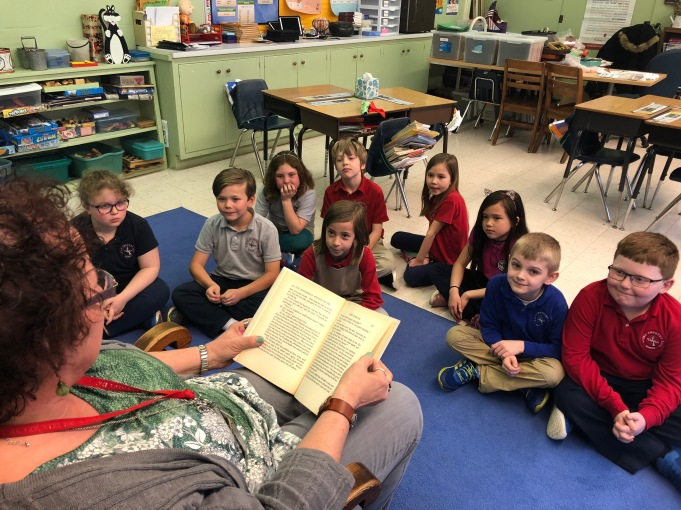 Students listen to Mrs. Ausherman's reading of The Wizard of Oz.